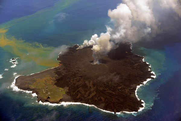 "This handout picture taken by Japan Coast Guard on July 23, 2014 shows the newly created islet (R) and Nishinoshima island (L), which are conjoined with erupting lava at the Ogasawara island chain, 1,000 kilometres south of Tokyo. A smouldering islet off Japan's Pacific coast has grown six times in its land surface since before it merged last December with a landmass created by volcanic eruptions. AFP PHOTO / JAPAN COAST GUARD---EDITORS NOTE---HANDOUT RESTRICTED TO EDITORIAL USE - MANDATORY CREDIT ""AFP PHOTO / JAPAN COAST GUARD"" - NO MARKETING NO ADVERTISING CAMPAIGNS - DISTRIBUTED AS A SERVICE TO CLIENTS"